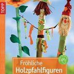 Fröhliche Holzpfahlfiguren: Holzpalisaden, dekorativ und farbenfroh verziert